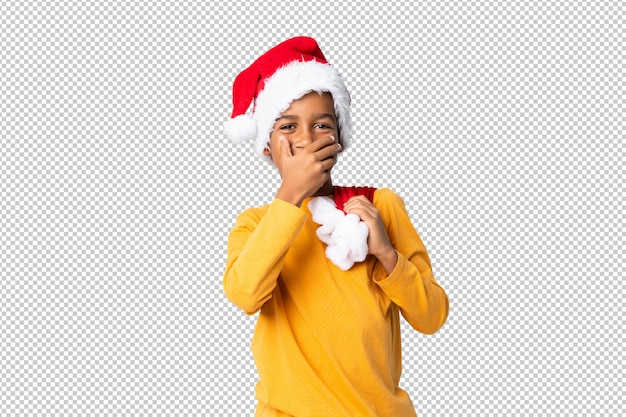 Afro-amerikaanse jongen met kerstmuts