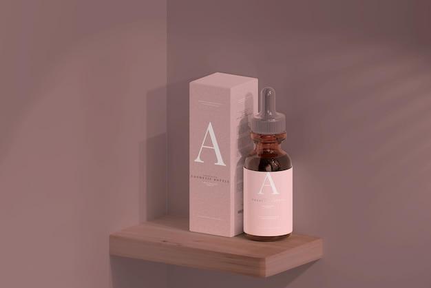 Amber glazen druppelflesje met doosmodel Gratis Psd