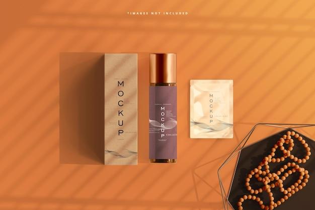 Amberkleurige glazen cosmetische fles met zakje en doosmodel