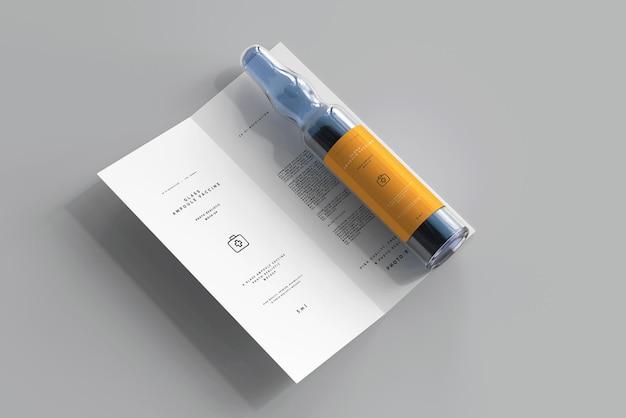 Ampolla de vidrio con maqueta de folleto plegable