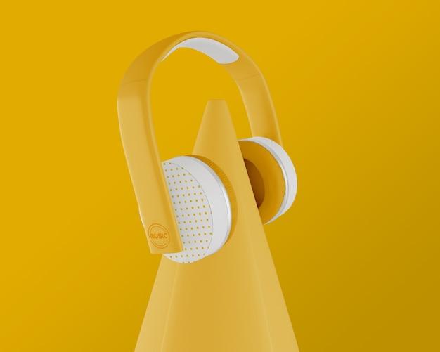 Arreglo con auriculares y fondo amarillos