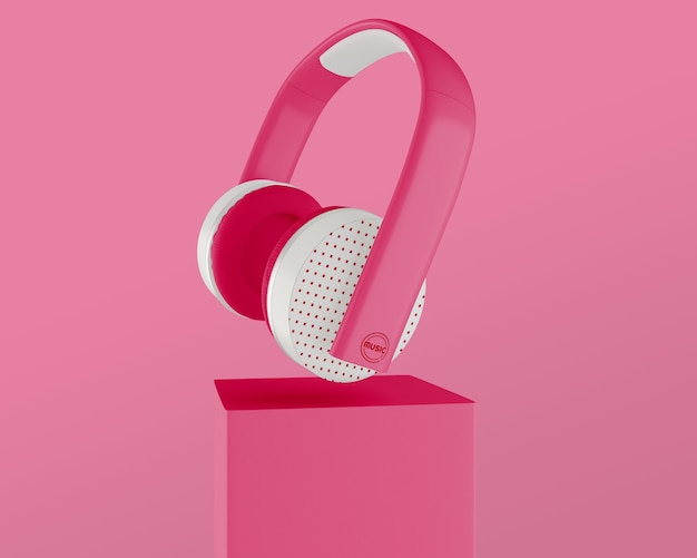 Arreglo con auriculares y fondo rosa