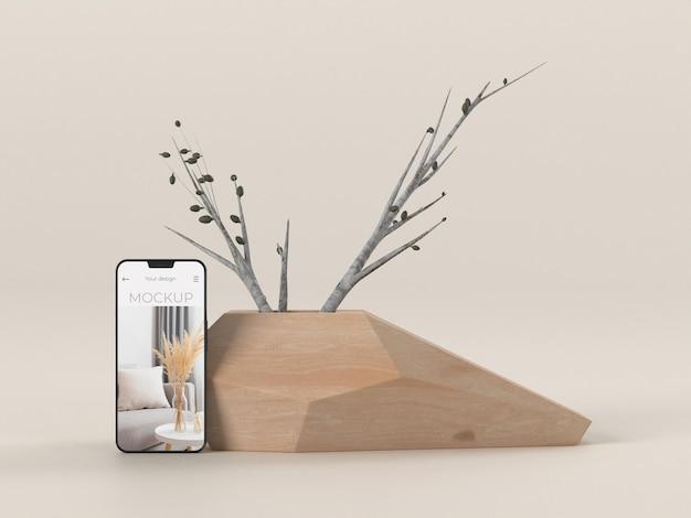 Arreglo elegante con maqueta de teléfono inteligente y jarrón