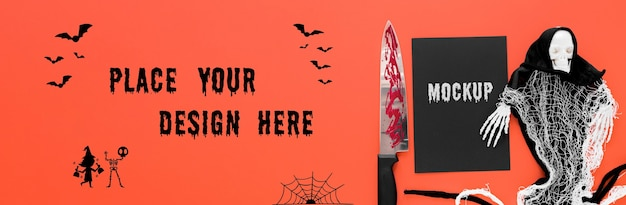 Arreglo espeluznante de halloween con cuchillo