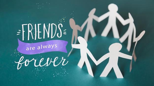 Arreglo para el evento del día de la amistad con personas de papel