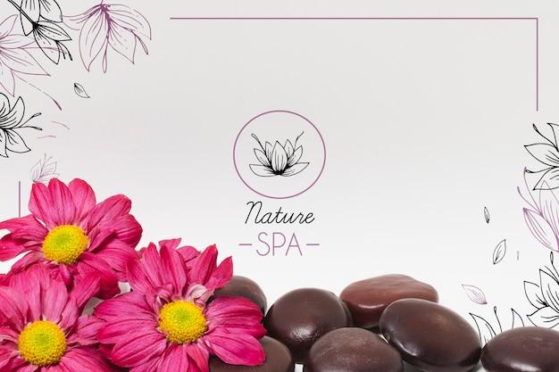Arreglo con piedras y flores para plantilla de salón de spa