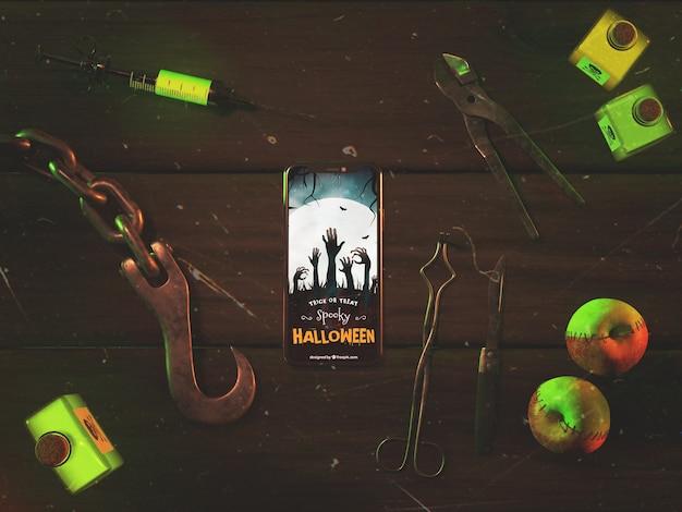 Arreglo plano de halloween con teléfono