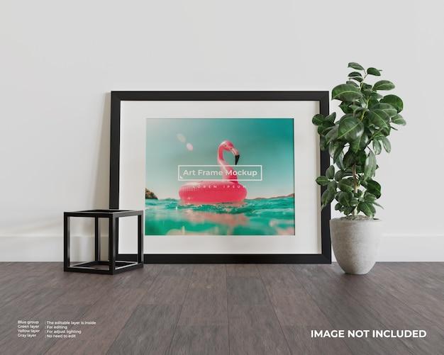 Art frame mockup op donkere houten vloer Premium Psd