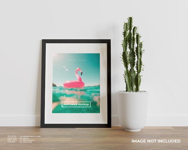Art frame mockup op houten vloer