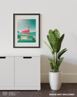 Art frame poster mockup bovenop de witte kast