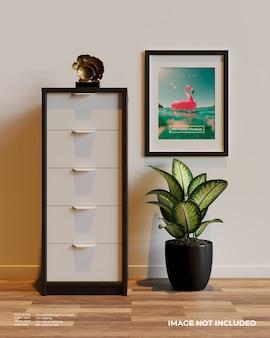 Art frame poster mockup naast de kast boven de planten