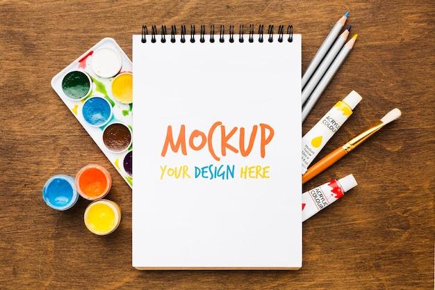 Artist desk concept met notebook