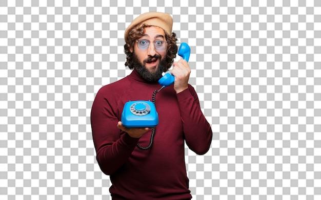 Artista francese con un berretto con un telefono vintage