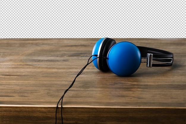 Auriculares azules en una superficie de madera