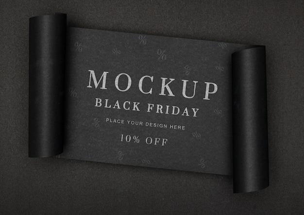 Banner enrollado de fondo negro maqueta de ventas de viernes negro