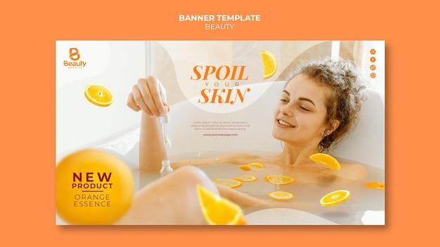 Bannermalplaatje voor home spa skincare met vrouw en sinaasappelschijfjes