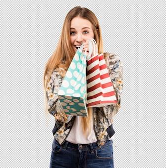 Bastante joven mujer sosteniendo bolsas de compras