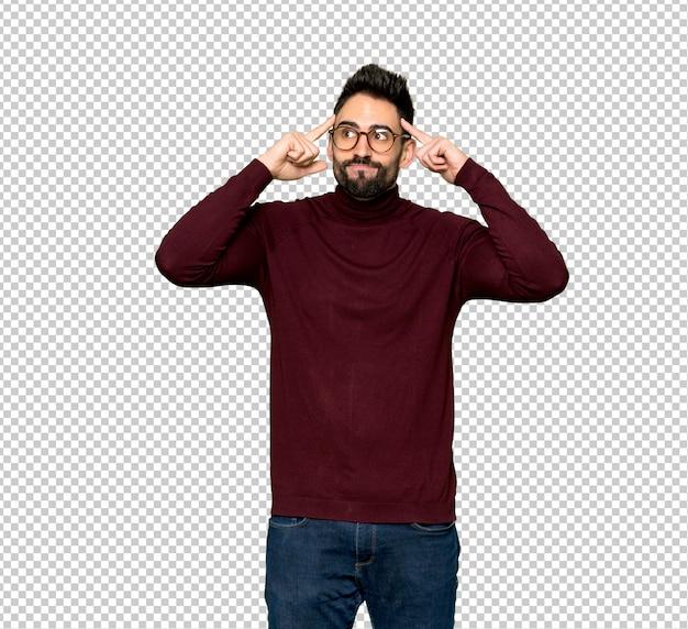 Bell'uomo con gli occhiali avendo dubbi e pensando