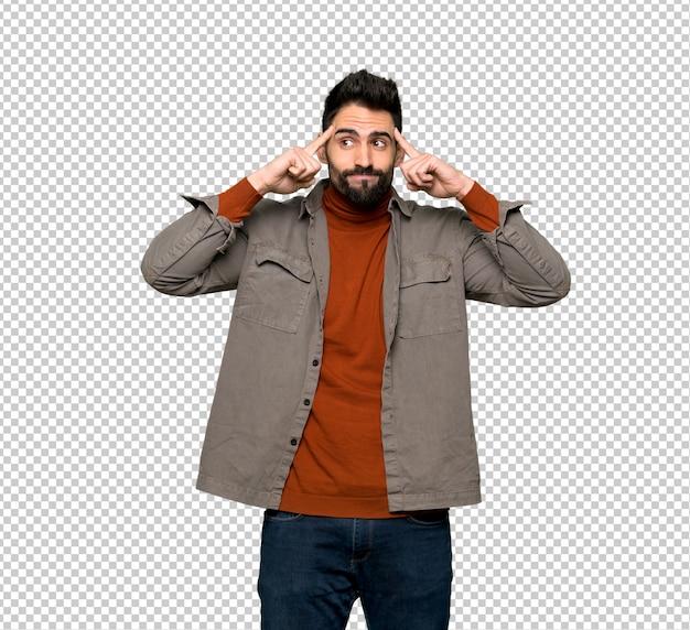 Bell'uomo con la barba avendo dubbi e pensando