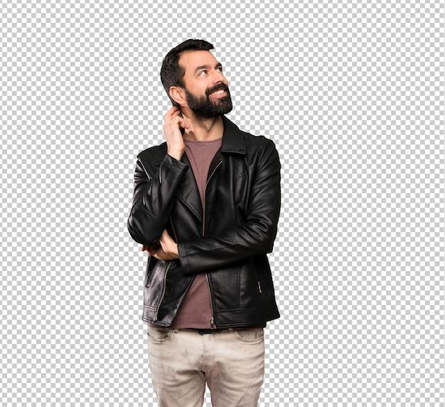 Bell'uomo con la barba pensando un'idea