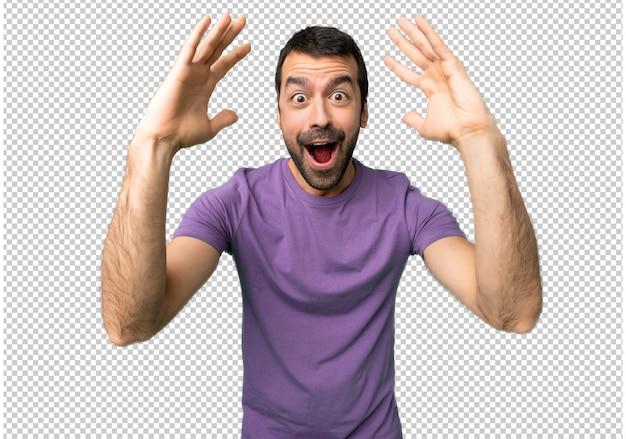 Bell'uomo con sorpresa e scioccato espressione facciale