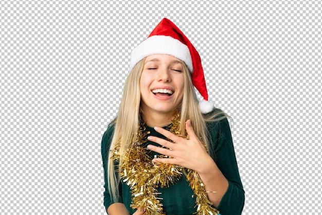 Bella mujer con sombrero de navidad aislado