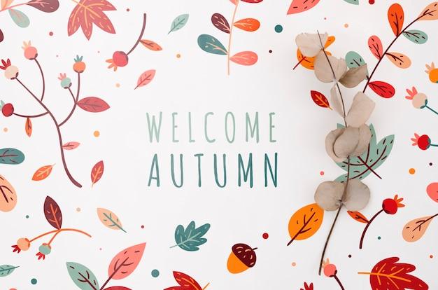 Benvenuto lettering autunnale con foglie intorno