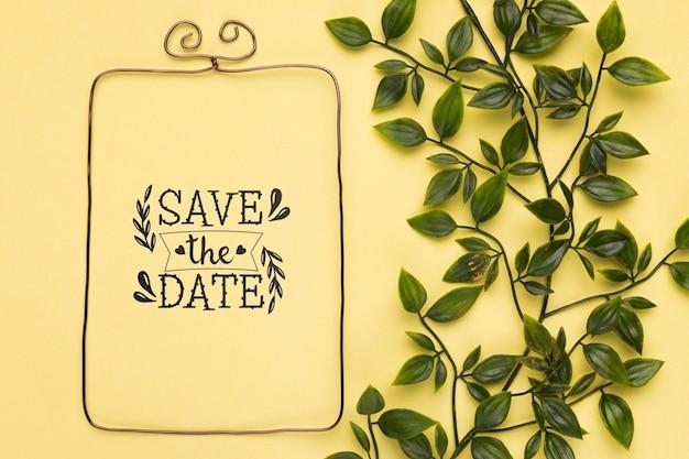 Bewaar de datum mock-up minimalistische frame en bladeren