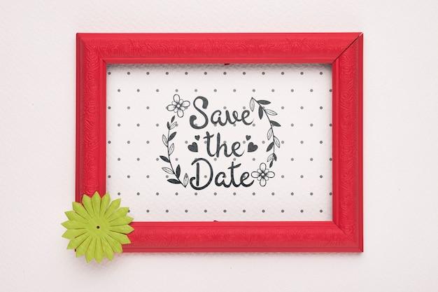 Bewaar de datum mock-up rood frame met gele bloem