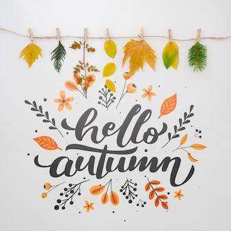 Bladeren die boven hallo de herfstconcept hangen