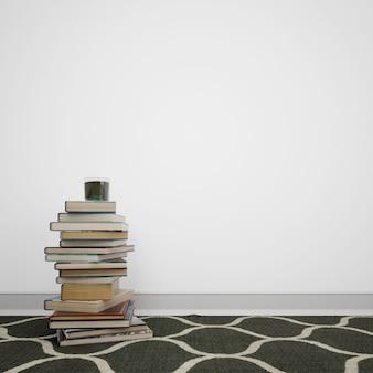 Boeken op de vloer naast de witte muur met copyspace worden gestapeld die