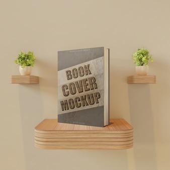 Boekomslag mockup op wandbureau met paar plantendecoratie