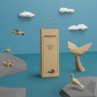 Bolsa de papel kraft y vida marina con concepto de maqueta