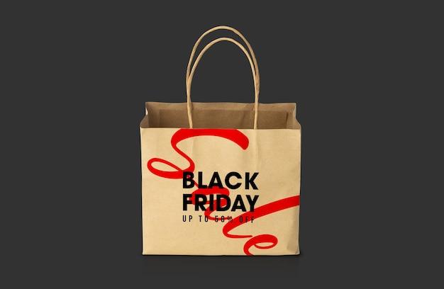 Bolsa de papel marrón kraft reciclado con maqueta de campaña de black friday