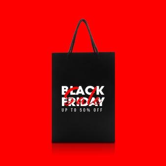 Bolsa de papel negra con maqueta de campaña de black friday