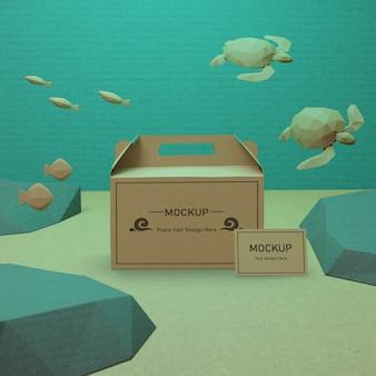 Bolsas de papel y tortugas del día del océano con maqueta