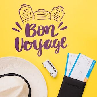 Bon voyage, buen viaje lettering con furgoneta, pasaportes y sombrero