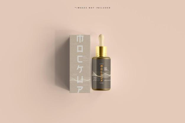 Botella cosmética con gotero y maqueta de caja
