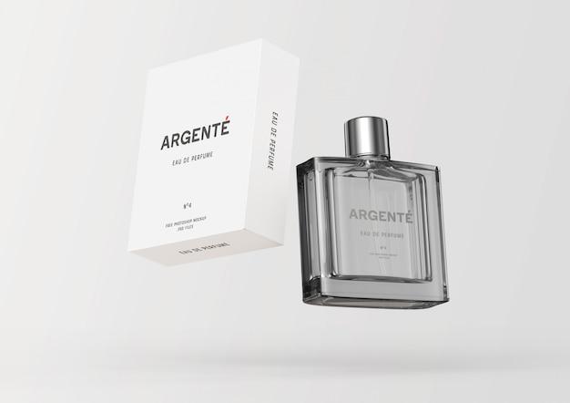 Botella de perfume flotante y maqueta de caja de embalaje