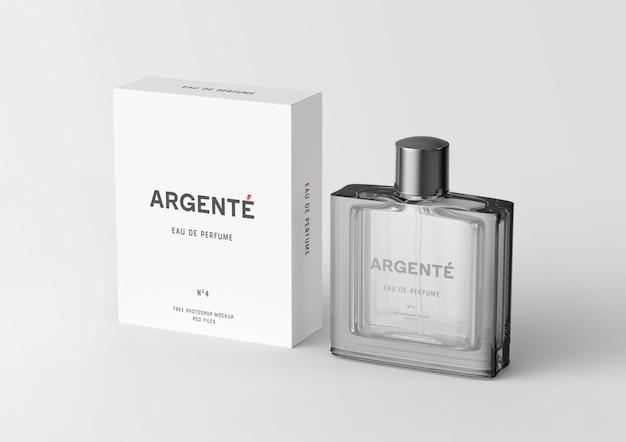 Botella de perfume de pie y maqueta de caja de embalaje