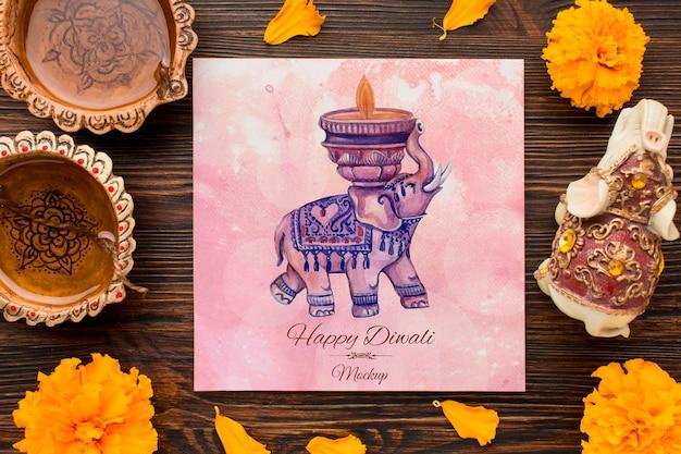 Bovenaanzicht gelukkige diwali festival mock-up olifant en bloemen