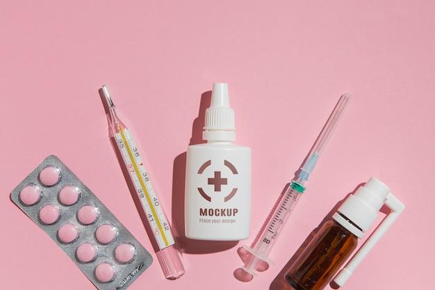 Bovenaanzicht geneeskunde met roze achtergrond