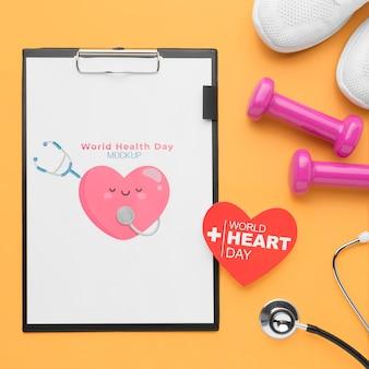 Bovenaanzicht gezondheidsdag mock-up met gewichten