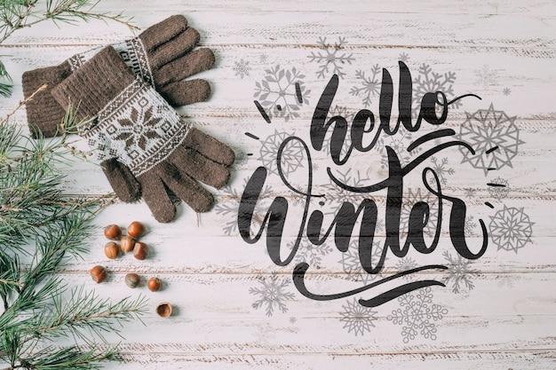 Bovenaanzicht hallo winter met warme handschoenen