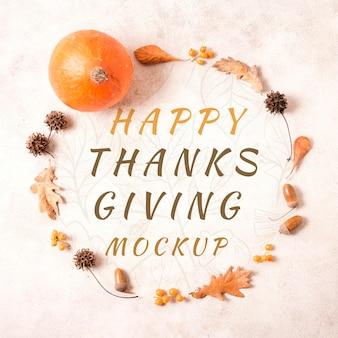 Bovenaanzicht happy thanksgiving krans van gedroogde bladeren mock-up