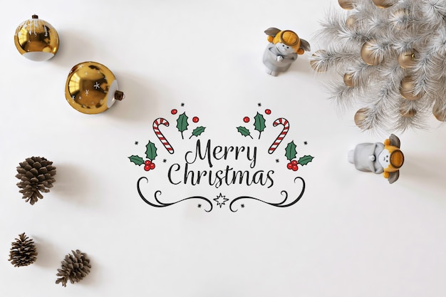 Bovenaanzicht merry christmas op witte mockup met kerstversiering