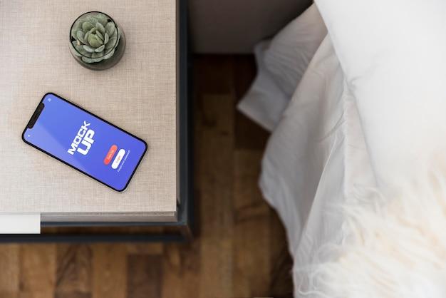 Bovenaanzicht mobiele telefoon met mock-up concept