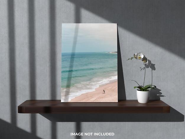 Bovenaanzicht mockup realistische fotolijst met bloem