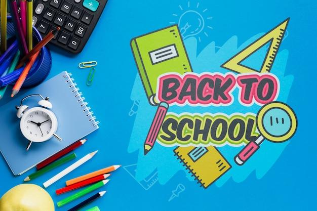 Bovenaanzicht terug naar school met blauwe achtergrond