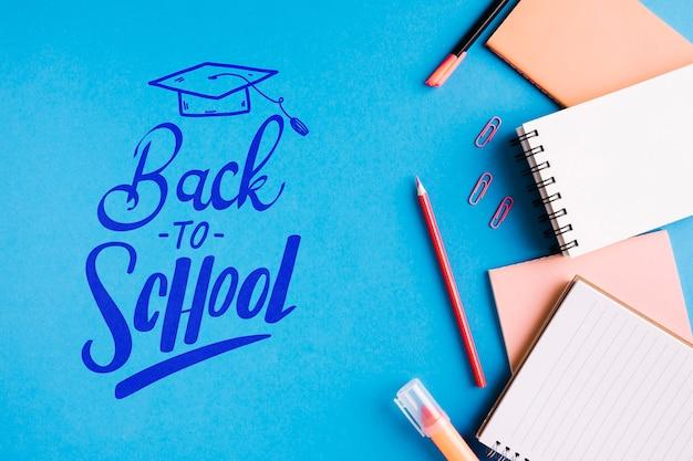 Bovenaanzicht terug naar school met kantoorbenodigdheden